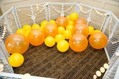 Balloon pit at a 1st Birthday Party via Kara's Party Ideas Kara'sPartyIdeas.com #TwinsBirthdayParty #Bee #Honeybee #Ideas #Supplies #GenderNeutral #balloonpit