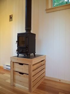 Photo: Hobbit wood stove by Salamander with wood/ kindling storage beneath- Can't say enough good things about this sweet little stove!