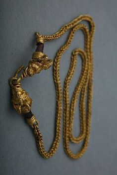 Necklace with Horned Lion's Head Finials Material(s): Gold Date of Object: 3rd century BC Origin: Greek Measurements(s): L: 40cm; Weight: 12.83g Provenance: The Georgian National Museum Find Location: Vani