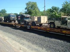MILITARY VEHICLES ON UP FREIGHT TRAIN