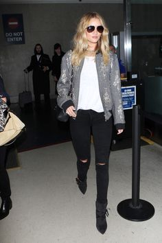 The supermodel-turned actress always knows how to make her skinny jeans feel fresh again—like adding an embellished bomber jacket.