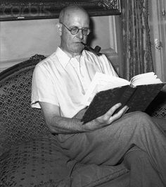 Author P. G. Wodehouse Smoking Pipe and Reading a Book