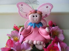 Pink fairy in her garden.
