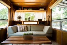 House Tour: A Peaceful, Bohemian Austin Homestead | Apartment Therapy - A vintage camper, with a few renovations, additions, and improvements can feel just like home whether it's parked or on the road. Class wood interior and mid-century vibes make this space so trendy and cool that you'll forget you've stepped into a trailer!