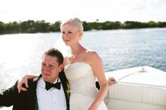 Couple arriving by boat to their reception from @katbraman photography