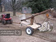 Homemade towed crane constructed from a concrete mixer frame, channel, pipe, angle iron, and a chain hoist. Farm Tools, Garden Tools, Atv Implements, Crane Lift, Block And Tackle, Welding Cart, Garden Tool Organization, Tool Room, Ideas
