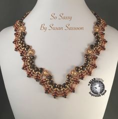 https://www.etsy.com/listing/499646140/ombre-scalloped-superduo-necklace