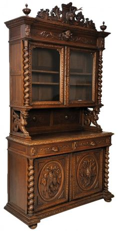 12: A HENRI II STYLE OAK BUFFET WITH EXCEPTIONAL CARVIN : Lot 12