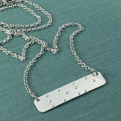 This becomes a nice conversation peice if you ever have low vision patients. Could say ThankYou! REAL BRAILLE Braille Necklace Braille by LoraDouglasJewelry