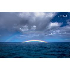 A beautiful vibrant double rainbow that can be seen in the distance of the amazing Pacific Ocean off the Coast of Oahu.
