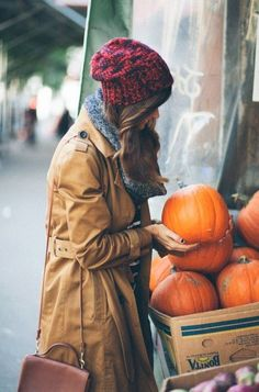 Cozy in a warm red hat and brown trench when its autumn in the city!