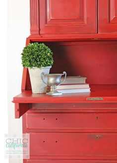 Tackle a fun DIY home decor makeover project this weekend and splash some red on an old hutch.