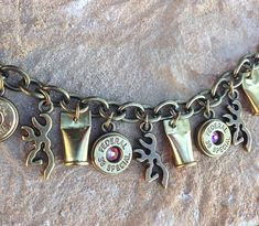 Bullet jewelry. Hunting / country charm bracelet with bullet casings and browning deer on Etsy, $24.99