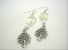 White Bead Peacock Charm Dangle Earrings by cynhumphrey on Etsy, $6.00