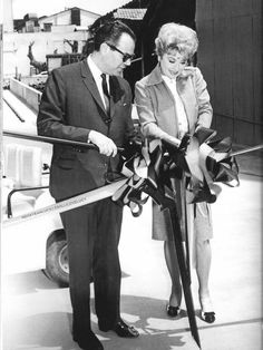 Lucille cuts a ribbon of 70mm film to mark the merger of two Hollywood studios, Paramount and Desilu, July 1967. With her is Charles G. Bluhdorn, Board Chairman of Gulf & Western. The deal cost Gulf & Western $17 million, of which $10 million went to Lucille. She insisted that no former employees of Desilu should lose their jobs.