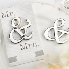 Mr. & Mrs. ampersand bottle openers are simple, chic, and meaningful wedding favors to hand out to guests as a reminder of your special event.