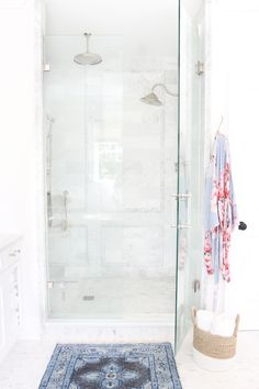 Love how bright the shower is and the slight difference in tile patterns Rug also super pretty The Kismet in Steel Rug by Caitlin Wilson featured in Monika Hibb's master bathroom Bathroom Renos, Bathroom Interior, Master Bathroom, Bathroom Ideas, White Bathroom, Bathroom Renovations, Bathroom Marble, White Shower, Marble Tiles