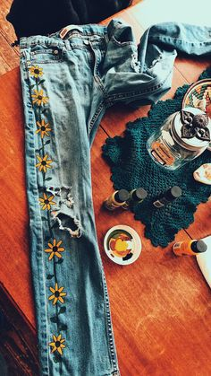 Yellow flowers painted on jeans