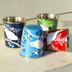 Painted metal cups for a baby.  Love!  Found via SouleMama- http://www.soulemama.com/soulemama/2012/02/for-the-newest-eater-amongst-us.html
