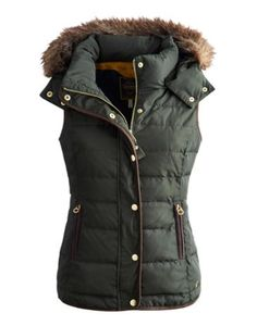Joules Womens Fitted Vest with Fur Trimmed Hood, Everglade Green.                     With a high quality faux fur trimmed detachable hood this vest is one of our most luxurious winter warmers.  With a gently curved hem and ruching to the waist it flatters while keeping you warm as toast.