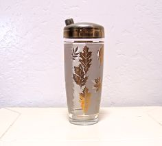 Vintage Libbey gold leaf cocktail shaker.