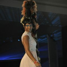 Tall black, blonde, and brunette beehive with long braid/ponytail and dramatic makeup. Brazil's submission for the World of Hairdressing Farouk Cancun Conference!