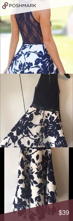 Women's floral, lace, navy blue and white dress Originally from Saved by the Dress. This is a flared dress with floral print at the bottom and lace at the top. The back is sheer lace. Only worn one time. **The size fits smaller than normal, so the Large fits like a medium** In great condition! Super cute! Dresses
