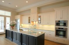 extend the kitchen into the breakfast room and add counter to the island with chairs
