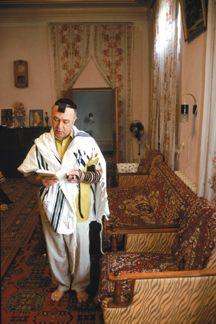 In Bukhara, Uzbekistan, Rafael Davydov, longtime president of the Bukharian Jewish community, davens barefoot in the morning in his bedroom. photo/bryan schwartz
