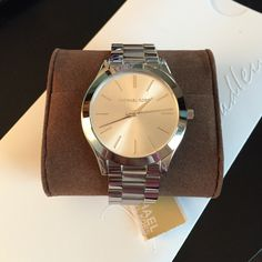 Silver Michael Kors watch Slim silver MK watch. I bought it but the face is too big for my wrist so it's never been worn or even sized. Comes with black box. 42 mm across the dial. MICHAEL Michael Kors Accessories Watches