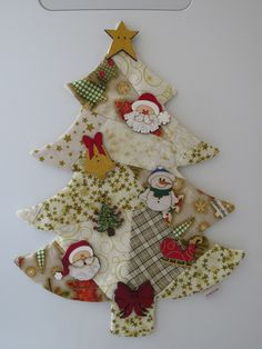 Very simple, 15 stuffed triangles with small baubles hanging between. Very simple, 15 stuffed triangles with small baubles hanging between. Fabric Christmas Trees, Hanging Christmas Tree, Felt Christmas, Christmas Tree Decorations, Christmas Stockings, Christmas Wreaths, Christmas Ornaments, Christmas Holidays, Xmas Crafts