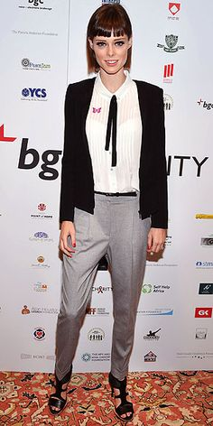 Last Night's Look: Love It or Leave It? | COCO ROCHA | Well, she is technically working! The model puts her unmistakable spin on menswear with a business suit-inspired tie-and-trouser combo a charity phone-a-thon for Cantor Fitzgerald and BGC's Annual Charity Day in NYC.