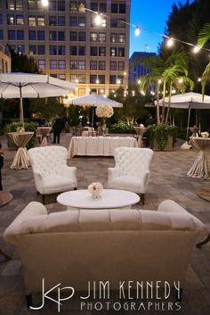 White lounge furniture for the outdoor cocktail hour at this Vibiana Wedding | Kelsey Events | Butterfly Floral and Event Design | Jim Kennedy Photographers