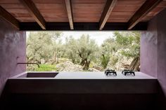 The Olive Houses are off-grid retreats hidden in Mallorca's mountains Green Apartment, Parisian Apartment, Paris Apartments, The Purple, Grid Architecture, Sage Green Kitchen, Olives, Herringbone Tile Floors, Sleeping Pods