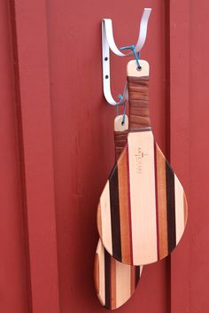ArteMare's Signature Beach Racquets with leather grips and walnut, mahogany and purple heart hardwoods.