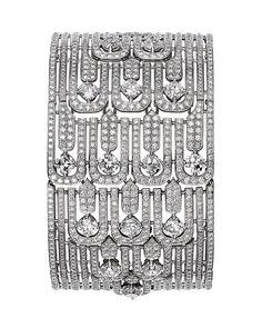 L'Odyssée de Cartier Parcours d'un Style 'The City' high jewellery bracelet in platinum, set with cushion-shaped diamonds and diamonds.