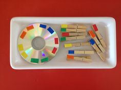 "I would divide the CD into sections and would write the colour names in French (written out with words).  Put in a ziplock baggie.  This could be an activity to do at a centre, or a ""J'ai fini"" activity to keep on the cart, or a partner activity when first learning the colours."