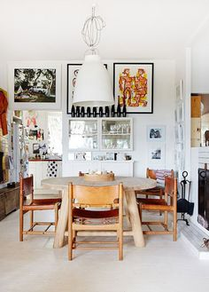 modern dining area with wood table and leather chairs / sfgirlbybay