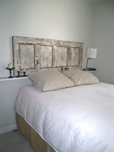 Exactly what I want to do for a headboard. But I would have hubby put legs on it and not have it floating LOVE vintage doors