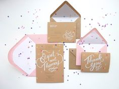 Fun colorful confetti wedding invitations. I like the big placement of the names written in cursive in the middle