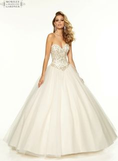 A gorgeous prom dress by Mori Lee. A beaded satin bodice with corset tie back and a tulle princess skirt.