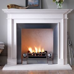 Chesneys. Traditional mantel with more modern surround and fire accessories.