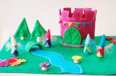 This set includes:  One Fairy play mat with leaf bridge. 19X11 Inches 4 fairies (2 girls and 2 boys) stand 2.5 inches tall and dressed in felt  One fairy