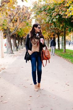 Camel sweater, quilted jacket, scarf, skinny jeans and ankle boots.