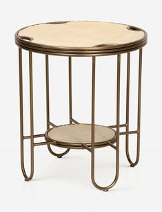 Combining all of our favorite elements of Art Deco style and natural materials, this round, tiered side table is a luxe statement with diamond-textured rattan and a curvy bronzed steel frame. It looks amazing topped with your favorite houseplant or a bold Wine Glass Shelf, Glass Shelves, Sunroom Furniture, Unique Furniture, Sage Green Walls, Picture Shelves, Living Room Shop, Bedroom Night Stands, Machine Made Rugs