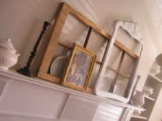 One Girl Three Brothers - old window layered on mantel - via Remodelaholic