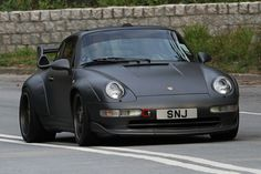 porsche 911 mat black with the wide body kit it works http://extreme-modified.com/