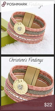 5 Layer Bracelet with Golden Charm Bracelet lays very nicely when worn. The bracelet closes with a magnetic band on each end of bracelet.  Strong magnetic closure, won't come undone until you, personally take it off. Christine's Findings  Jewelry Bracelets