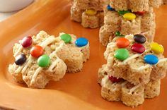 Peanut Butter-Polka Dot Crispy Treats |    150  Ooey-gooey marshmallow treats made even better with rich peanut butter and topped with melted white chocolate and colorful candy. You rock, Mom.