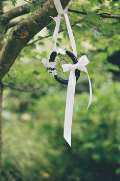 Hanging horseshoe wedding decor. See more here: Love Filled Outdoor Garden Wedding, Cornwall | Confetti Daydreams ♥  ♥  ♥ LIKE US ON FB: www.facebook.com/confettidaydreams  ♥  ♥  ♥ #Wedding #GardenWedding #OutdoorWedding #RealBride